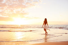 Happy Carefree Woman on the Beach at Sunset Royalty Free Stock Images