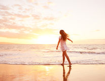 Happy Carefree Woman on the Beach at Sunset Royalty Free Stock Photography