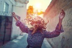 Happy carefree woman dancing on street Stock Image