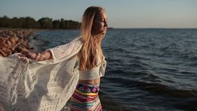 Happy carefree woman enjoying sunset on the beach stock video