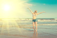 Happy Carefree Woman. Enjoying Beautiful Sunset on the Beach, Relaxing and Enjoying Freedom and Life royalty free stock photos