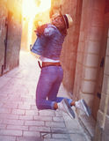 Happy carefree woman jumping on mediterranean street Royalty Free Stock Image
