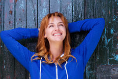 Happy carefree woman laughing and looking up Stock Images