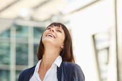 Happy carefree woman laughing outside in city Royalty Free Stock Photography