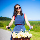 Happy carefree woman riding vintage bicycle Royalty Free Stock Photo