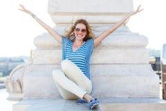 Happy carefree woman sitting Stock Photos