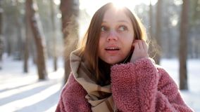 Happy carefree young woman dancing and listening to music from smartphone. dancing against the background of the winter stock video footage