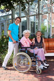 Happy Caregivers and Elderly Portrait. Royalty Free Stock Photos