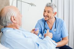 Happy Caretaker Discussing Prescription With Royalty Free Stock Photo