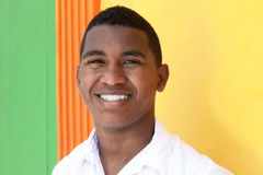 Happy caribbean guy in front of a colorful wall Stock Image