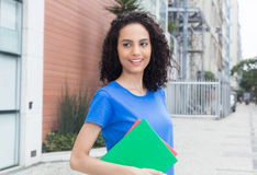 Happy caribbean student with books in the city Royalty Free Stock Photo