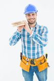 Happy carpenter carrying wooden planks Stock Photography