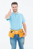 Happy carpenter gesturing thumbs up Stock Image