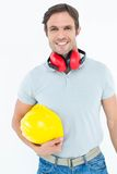 Happy carpenter with hard hat and ear protectors Stock Photos