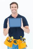 Happy carpenter holding digital tablet Royalty Free Stock Photos