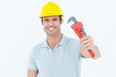 Happy carpenter holding monkey wrench Royalty Free Stock Image