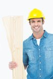 Happy carpenter holding wooden planks Royalty Free Stock Photography