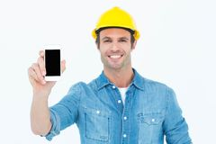 Happy carpenter showing smart phone Stock Photography