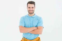 Happy carpenter standing arms crossed Royalty Free Stock Photos