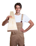Happy carpenter with wooden beam Royalty Free Stock Images