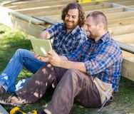 Happy Carpenters Using Digital Tablet At Royalty Free Stock Image