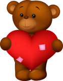 Happy cartoon bear holding heart Royalty Free Stock Images