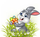 Happy cartoon bunny holding an Easter egg Stock Image