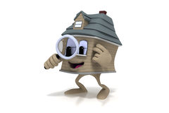 Happy cartoon house holding a magnifying glass Royalty Free Stock Photo