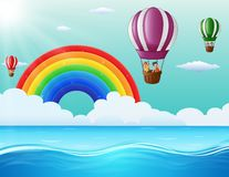 Happy cartoon kids flying in a hot air balloon in ocean Stock Images
