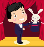 A happy cartoon magician pulling a rabbit out of h vector illustration