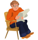 Happy cartoon man sitting in armchair in orange sweater reading Stock Photos