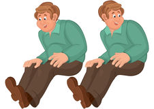 Happy cartoon man in sitting position in green top Royalty Free Stock Photo