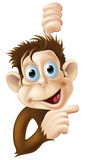 Happy cartoon monkey pointing Royalty Free Stock Image