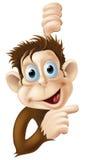 Happy cartoon monkey pointing Royalty Free Stock Image