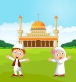 Happy cartoon Muslim kids waving hand in front of mosque Stock Image