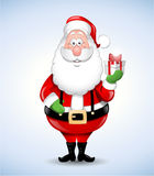 Happy cartoon Santa Claus holding a gift Stock Images
