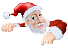 Happy cartoon Santa pointing down Stock Image