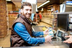 Happy cashier at the cash register stock photo