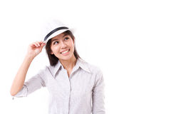Happy casual asian woman with white hat. White isolated background Royalty Free Stock Photography