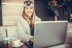 Happy casual beautiful woman watching videos on a laptop stock photo