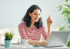 Woman working on a laptop stock images
