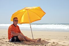 Happy casual blonde guy in orange outfit Royalty Free Stock Photos