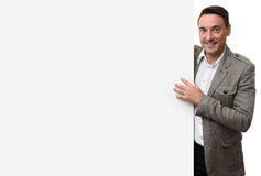 Happy casual business man with blank advertising board Stock Images