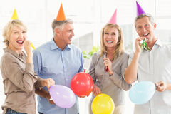 Happy casual business people celebrating birthday Royalty Free Stock Image