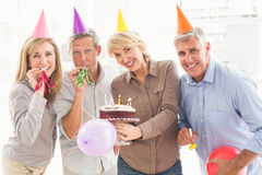 Happy casual business people celebrating birthday Stock Image