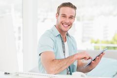 Happy casual businessman using tablet Royalty Free Stock Photo