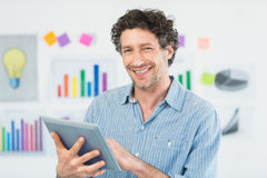 Happy casual businessman using tablet Royalty Free Stock Photography