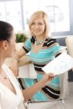 Happy casual businesswoman working with colleague Royalty Free Stock Photos