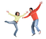 Happy casual couple jumping up Stock Photos
