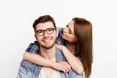 Happy casual couple posing to camera, isolated Royalty Free Stock Photos